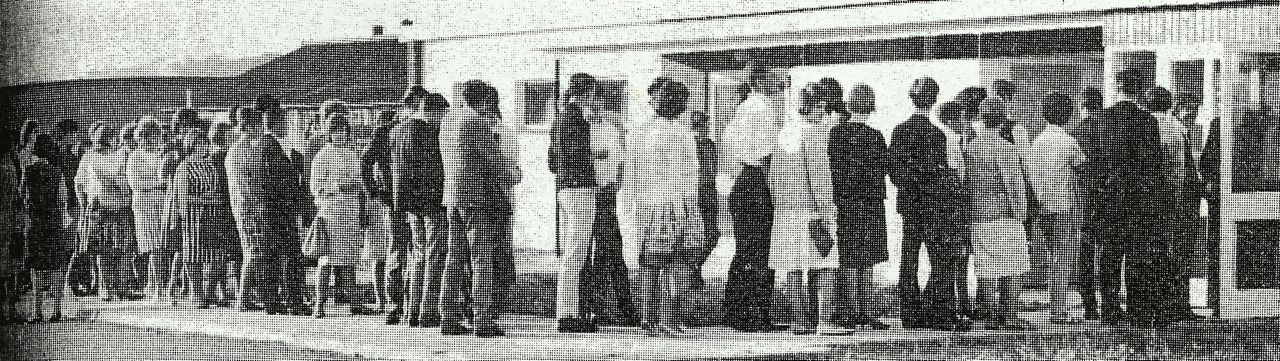 Newspaper clipping image of people queuing to enter Maxwell Park Community Centre