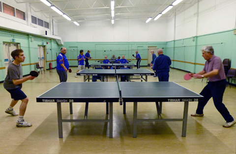 Photograph of Table Tennis Club playing table tennis